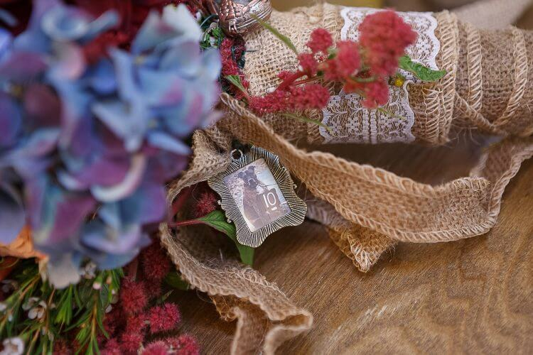 Remember love ones on a charm of a photo on a bouquet
