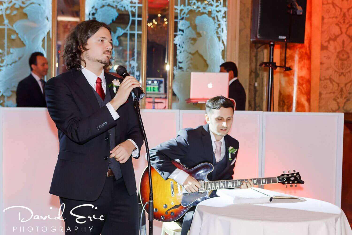 Family playing music at New Jersey wedding reception