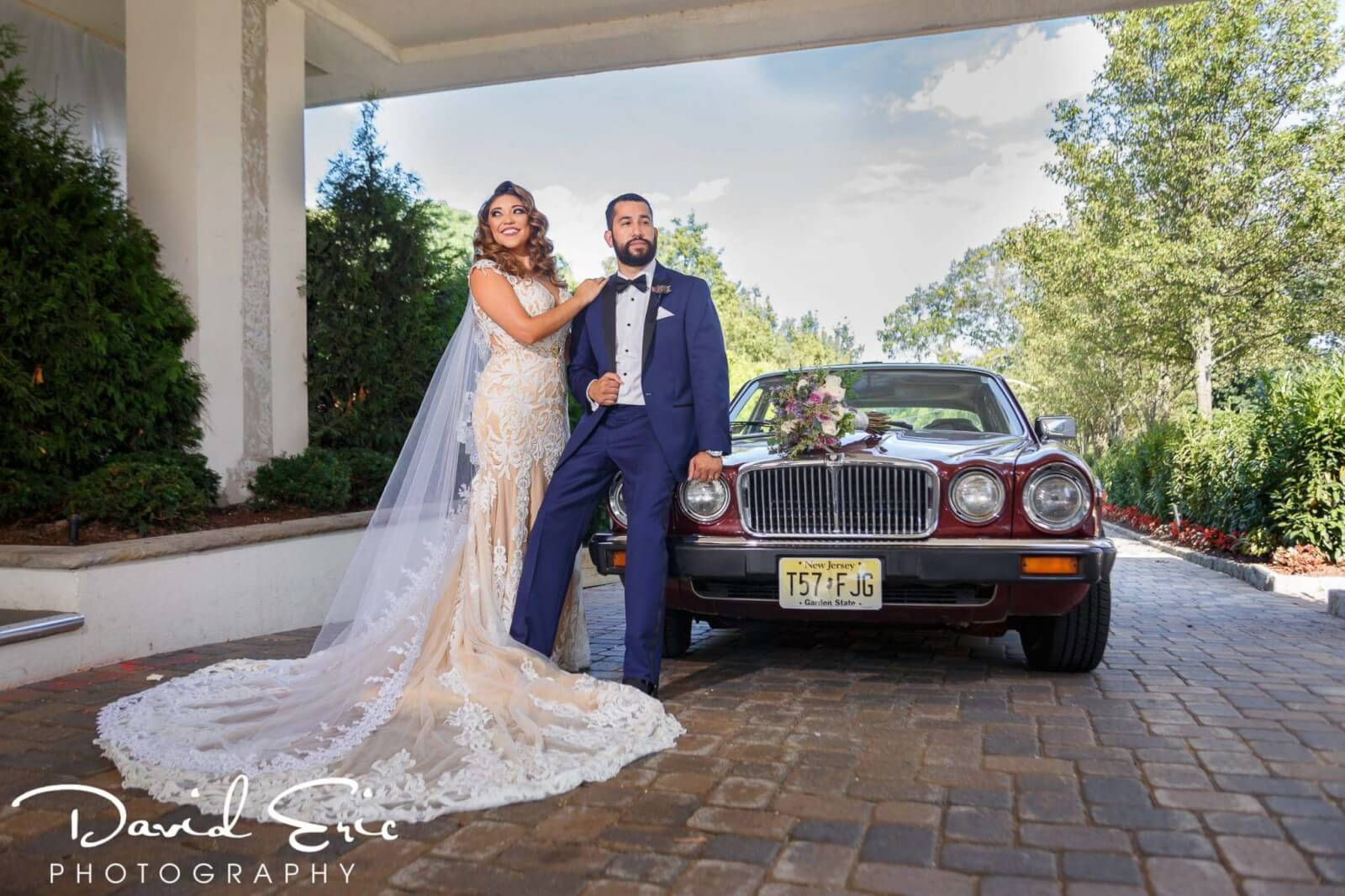 Wedding Venues New Jersey The Tides Estates bride and groom on jaguar in front of the venue